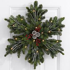 Give a gift as beautiful as fresh snow on Christmas morning. This stunning snowflake wreath is handcrafted with fresh, fragrant Noble Fir and decorated with painted pinecones, red faux berries, and… Decoration Christmas, Noel Christmas, Rustic Christmas, Xmas Decorations, Christmas Ornaments, Christmas Morning, Christmas Ideas, Christmas Inspiration, Homemade Decorations