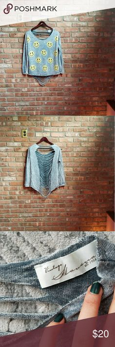 "Vintage Havana Destroyed Slouchy Tee Smiley Face All measurements were taken flat laid.  24.5"" long, 21"" shoulder to shoulder,  24"" armpit to armpit,  20"" sleeve length.  Blue gray color. Distressed cutout back. Smiley faces on the front. Good condition.  No stains. Contact if you have questions. Thanks. Vintage Havana Tops"