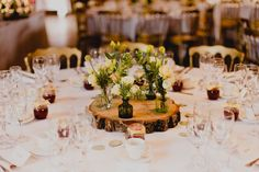 Wood round table center piece with yellow and white flowers