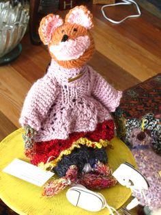 petit renard wearing a pink dress