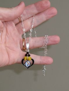 Pittsburgh Steeler Inspired Sweet on the Steelers Heart Necklace. $28.00, via Etsy.