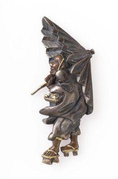Menuki in the form of a temple guardian with lamp and umbrella  Japanese, Edo Period, mid-19th century, Main material: shibuichi; other metals: gold and copper; decorative technique: uchidashi, takabori, iroe takazogan, MFA