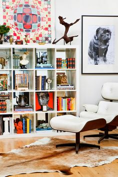 IKEA SPOTTED // EXPEDIT 4x4 bookcase in white  GET THE LOOK @ IKEA // KOLDBY cowhide  Eames chairs and cute pugs!