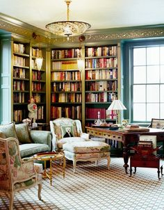 Reminds me of a lady's office from the early 1900s. - yes it does! It's lovely, I love the details and the bookcases