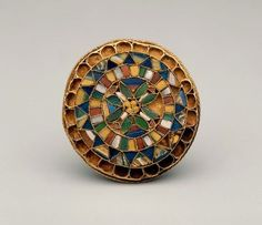 Circular brooch made of gold and colored glass, Italian, early 7th C.