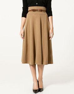 \\ camel skirt, black cardigan, cognac belt w/bow detail & black pumps