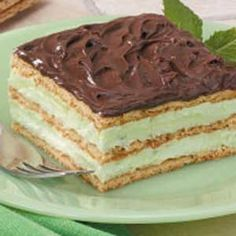 Pistachio Eclair Dessert: 3 c. cold whole milk- 1 pkg.(3.4 oz) instant pistachio pudding mix- 1 pkg (3.4 oz) instant French vanilla pudding mix- 1 (8 oz) frozen whipped topping, thawed- 1 pkg (14.4 oz) graham crackers- 1 can (16 oz) chocolate frosting...