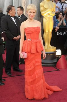 Michelle Williams... a darling coral dress again with an old Hollywood glam take. A fascinator would be darling for the races.