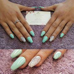 Mint green and silver acrylic nails. Gel polish
