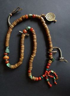 "TIBET, ""Mala"", buddhist rosary with 108 prayerbeads made of human bones to emphazise the transitoriness of life. The partition beads are made of amber, turquoise and cornelian. The locket with the zodiac, the signet and other beads are brass and silver.ndefined"