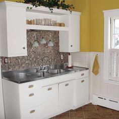 One Milton, Massachusetts, couple gave their old kitchen a stylish yet frugal makeover. They wanted to keep some of the original retro details like the stainless-steel sink and metal cabinets. After deciding to go with mostly surface updates to their kitchen, they saved a huge chunk of cash—and maintained the kitchen's vintage charm.
