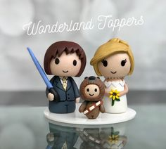 Wonderland Toppers make the cutest wedding cake toppers that you've probably ever seen. From action superheros to movie characters, or you can even have truly personal toppers crafted based on your interests and your individual wedding looks. Wedding Cake Toppers, Wedding Cakes, Star Wars Cake Toppers, Cupcakes, Wedding Looks, Wonderland, Super Cute, Crafts, Mariage