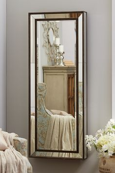 Using a mirror to make a room appear larger is a classic designer trick. Making that mirror functional is a stroke of genius. Pier 1's Gabrielle Mirrored Jewelry Armoire is beautifully hand-painted with a natural wood finish for contemporary flair and a French cleat for optional wall mounting. Inside are ring holders, hooks for hanging necklaces and compartments for loose treasures.