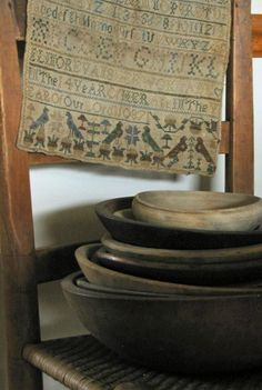 Cross stitch sampler and wooden bowls...