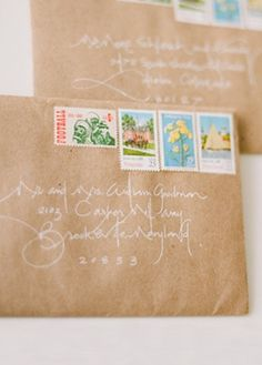 Love this! brown paper envelopes white calligraphy