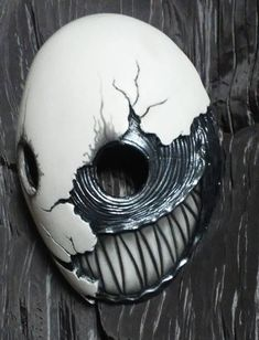 This is a new version of one of my existing masks ( https://www.etsy.com/listing/185234039/smile-original-hand-made-mask ) This is a resin cast mask. Its light weight and secures in place with elastic. Note: -Paint will be replicated as closely as possible but 100% identical is not