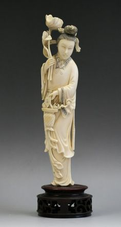 A Chinese Carved Qing Ivory Beauty With Flowers.