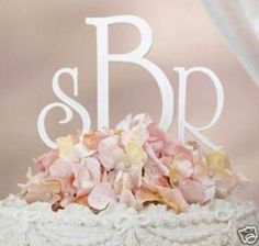 I prefer a monogram so bride toppers. These are only about $10 on ebay, available in silver and rhinestones too.