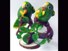 Exquisitely detailed hand carved tagua nut figurine of a pair of #green #parrots.