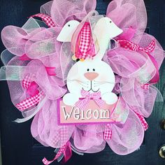 A large beautiful deco mesh  Easter Bunny wreath to celebrate your Easter.