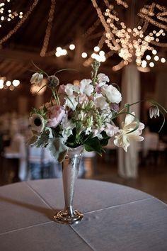 Beautiful centerpiece in a barn wedding at Fearrington