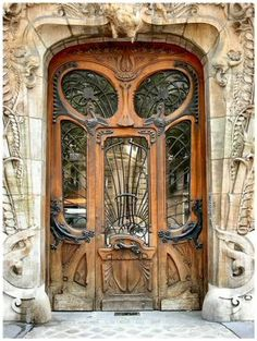 29 Avenue Rapp, Paris, France. The front door with it's ironwork, windows and wood carvings, surrounded by the artists vision in limestone is stupendous.