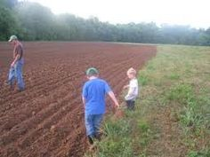 walking barefoot in a freshly plowed field-I have precious memories of this myself!! This Daddy is making memories