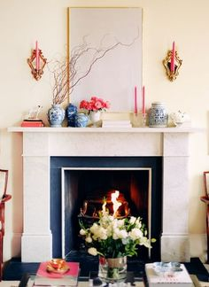 white framed canvas over fireplace with sconces  home of Rosaline of This is Glamorous