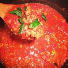 Spicy Abruzzi Italian Sauce STEP 3: ADD SPICY ITALIAN SAUSAGE UNTIL COOKED, 1 CUP OF WHITE WINE UNTIL IT EVAPORATES, TOMATOES, BASIL, RED PEPPER FLAKES