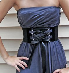 solid black corset wide belt :) also like the color and material on the dress