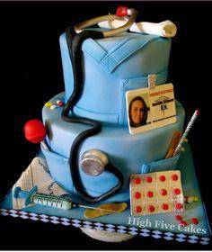 I like some of the details on this nurse cake like the syringe, stethoscope, etc