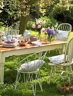 ❀ Like the idea of different chairs all painted white.
