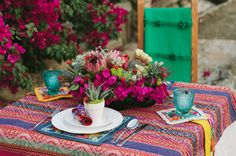 Vibrant textiles & succulents create an intimate, yet fun setting.