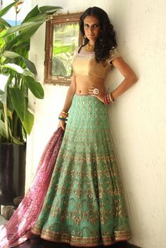 Green and gold lehenga choli with pink dupatta