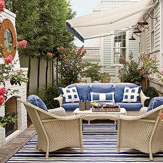 Make your outdoor space more like an indoor one with sturdy furniture and a rug.