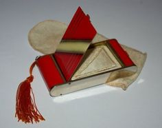 """taishou-kun:  """" Art Deco camera shaped compact for powder, lipstick and cigarettes holder decorated with a geometric Art Deco design in bright red and cream enamel on a chrome metal ground - 102x51x16 mm - Japan - 1930s  Source etsy.com  """" (=)"""