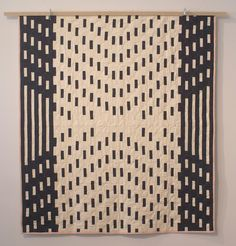 Meg Callahan's Porter pattern quilt was inspired by strip quilting, a traditional technique originally used to speed up the process of patchwork quilting. This originally appeared in Dwell& 12 Picks for Cozy Interiors. Art Textile, Textile Patterns, Quilt Patterns, Impression Textile, Black And White Quilts, Black White, Two Color Quilts, Quilt Modernen, Strip Quilts