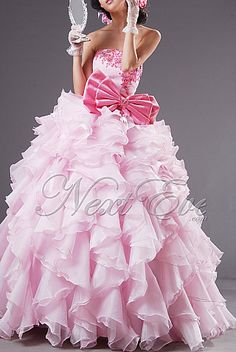 Fabulous Pink Strapless Layered Ball Gown Prom dress -- without the big pink bow!  RUFFLES RUFFLES  RUFFLES.........