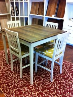 Pub table and chairs. Sanded, stained and varnished the top and chalkpainted and wAxed the legs and chairs. Recovered seat cushions.