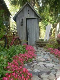 I've always thought an old outhouse-style building would be a great place to store garden tools.