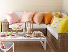 Colorful pillows make outdoor furniture welcoming.