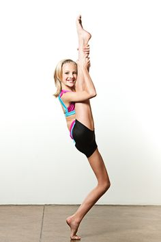 Paige showing off her flexibility at OXYjEN's Dance Moms photo shoot