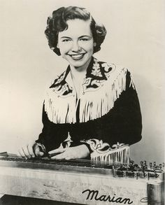 Marian Hall, lap steel player from the 1950s wearing an absolutely stunning western shirt with fringing applique. vintage western shirt