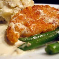 Crispy Chicken Costoletta: chicken breasts, lemons, breadcrumbs, parmesan cheese, eggs, flour, pepper, kosher salt, garlic, oil, heavy cream, Dijon mustard, chicken stock, lemon juice, butter