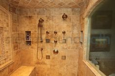 Image from http://www.docxie.com/wp-content/uploads/2014/10/bathroom-marvellous-kohler-steam-generator-and-water-tiles-design-ideas-with-granite-wall-feat-gold-color-shower-creative-idea-captivating-natural-stone-shower-bathroom-inspirations.jpg.