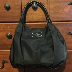 Black Kate Spade purse Good condition - no flaws on the outside. Normal use on the inside but no rips or tears anywhere. kate spade Bags Hobos