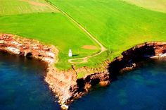 View of a lighthouse from our air tour of the island - beautiful view of the shoreline and water Photo Contest, Lighthouse, Golf Courses, Tours, Island, History, Water, Beautiful, Bell Rock Lighthouse