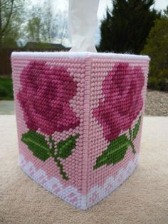 Rose Tissue Topper. Pinks, mauves, berries with white lace design. Measures 4 1/2 x 6. Made with extra firm plastic canvas for stiffness. All edges are double stitched. This would be great for a Birthday or Mothers day gift. Very feminine!  All other items ship free when purchased with this item.