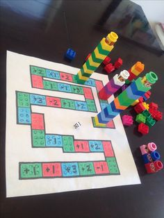 Begeleide of zelfstandige activiteit - Lego game board. Roll dice to move around the board. Tallest tower in the end wins! Lego Activities, Lego Games, Math Games, Math For Kids, Crafts For Kids, Lego Therapy, Lego Club, Montessori Math, Math Addition