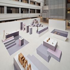 Nendo has used different tones of pink and purple to create the illusion of 3D display stands at an exhibition on Japanese design that the studio curated in